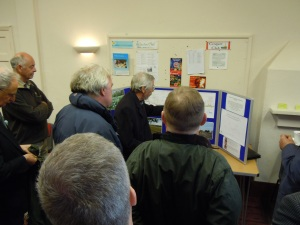 Gathered around the display board in Offchurch village hall
